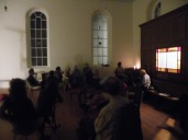 Jim Ghedi introducing a piece on the Capel's semi-functioning organ